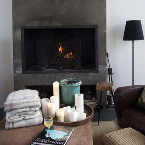 A cozy christmas fireplace in Iceland featuring folded Lopi wool blankets.