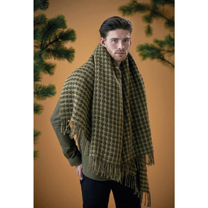 A man wearing a green Lopi Wool Blanket as a scarf.