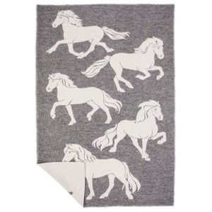 Hestar, a grey and white reversible Lopi Icelandic wool blanket with a woven horse design.