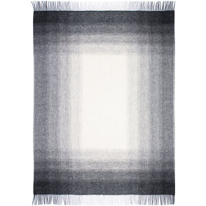 Tónar, a Lopi Icelandic wool blanket that fades from white in the center to dark grey on the edges.