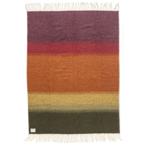 Flói, a burgundy, red, orange, yellow, and green gradient striped Lopi Icelandic wool blanket.