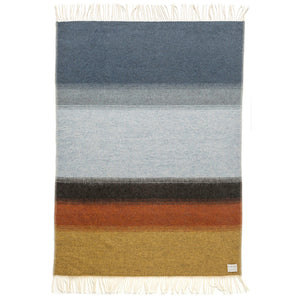 Land, a grey, brown, orange, and yellow gradient striped Lopi Icelandic wool blanket.