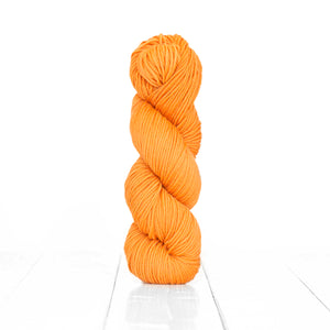 Color Orange, hand-dyed skein of yarn, vibrant orange yellow color produced from natural oranges.