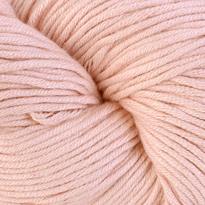 Brenton Point 1610, a pastel peach skein of Berroco's worsted weight Modern Cotton.