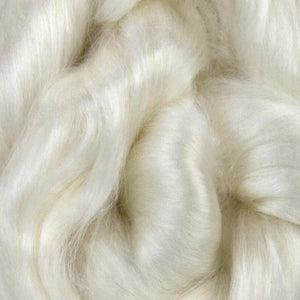 A close up of white undyed rose spinning fiber top.