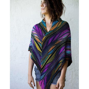 Model wearing knitted Butterfly/Papillon Shawl with blue, orange, and purple colorwork.