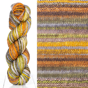 Color 4001: a hand-dyed skein of self striping wool yarn with orange, grey, white, and yellow shades