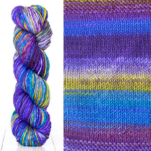 Color 4003: a hand-dyed skein of self striping wool yarn with blue, purple, white, and yellow shades