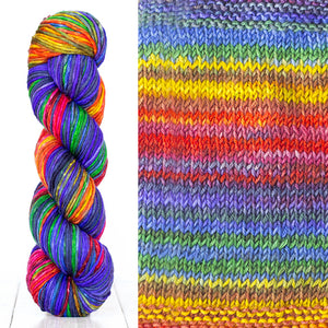 Color 4004: a hand-dyed skein of self striping wool yarn with blue, red, white, and yellow shades