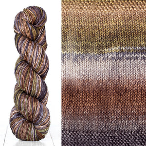 Color 4006: a hand-dyed skein of self striping wool yarn with brown, white, grey, and tan shades