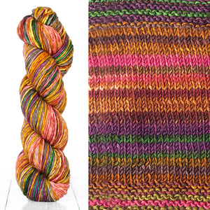 Color 4008: a hand-dyed skein of self striping wool yarn with brown, pink, orange, and purple shades