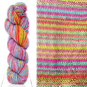 Color 4014: a hand-dyed skein of self striping wool yarn with pink, purple, blue, and yellow shades