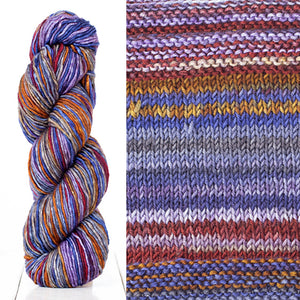 Color 4017: a hand-dyed skein of self striping wool yarn with purple, grey, brown, and blue shades