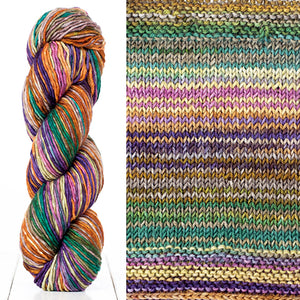 Color 4019: a hand-dyed skein of self striping wool yarn with purple, yellow, green, and white shade