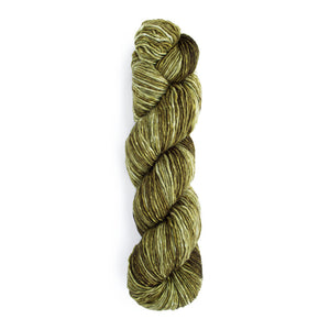 A twisted hank of Monokrom Worsted in color 4059, a tonal olive green.