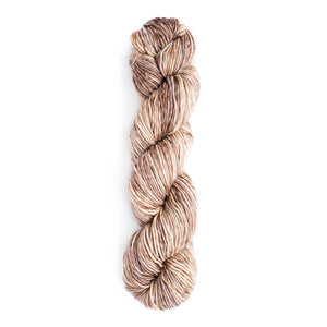 A twisted hank of Monokrom Worsted in color 4062, a tonal light warm tan.