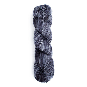 A twisted hank of Monokrom Worsted in color 4063, cool tonal greys.