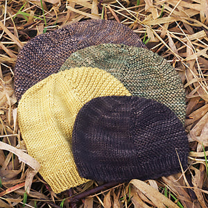 A pile of 4 Barley Hats in different sizes and colors.