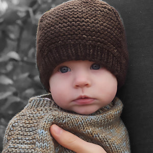 The Barley Hat on a baby looking at the camera.