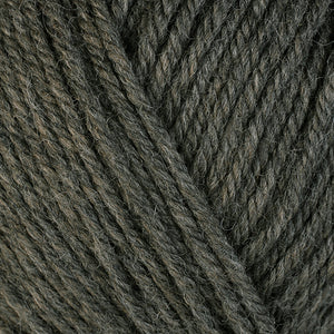 Bark 33130 a heathered grey-brown skein of washable worsted weight Ultra Wool yarn.