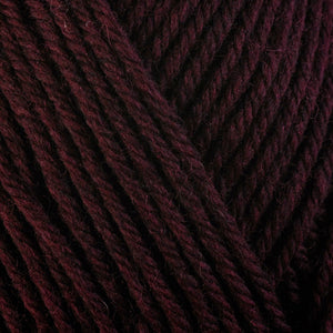 Beet Root 33151, a dark burgundy red skein of washable worsted weight Ultra Wool yarn.