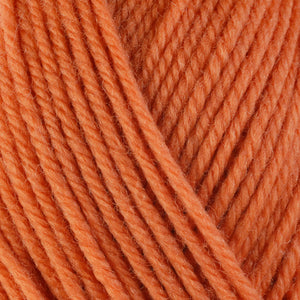 Bittersweet 3328, a soft yellow-orange skein of washable worsted weight Ultra Wool yarn.