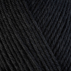 Black Pepper 33113, a heathered black skein of washable worsted weight Ultra Wool yarn.