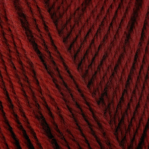 Brandy Wine 33133, a rich red skein of washable worsted weight Ultra Wool yarn.