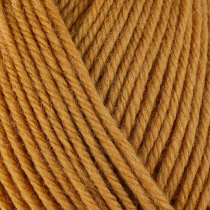 Butternut 3329, a cozy golden skein of washable worsted weight Ultra Wool yarn.