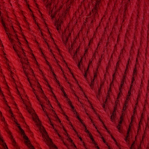 Chili 3350, a bright fiery red skein of washable worsted weight Ultra Wool yarn.