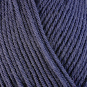 Columbine 3320, a dusty purple-blue skein of washable worsted weight Ultra Wool yarn.