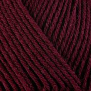 Currant 3360, a rich dark wine red skein of washable worsted weight Ultra Wool yarn.