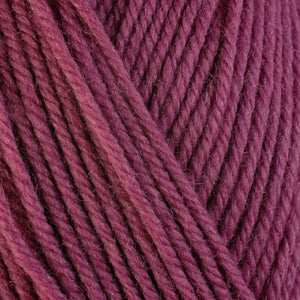 Lily 3321, a dusty pink skein of washable worsted weight Ultra Wool yarn.