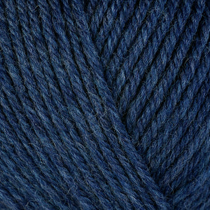 Delphinium 33138, a heathered deep blue skein of washable worsted weight Ultra Wool yarn.