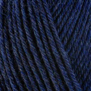 Denim 33154, a dark heathered blue skein of washable worsted weight Ultra Wool yarn.