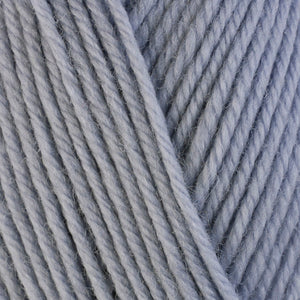 Dove 3311, a light soft grey skein of washable worsted weight Ultra Wool yarn.