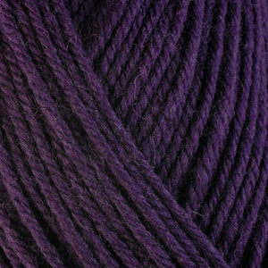 Fig 3362, a dark rich purple skein of washable worsted weight Ultra Wool yarn.
