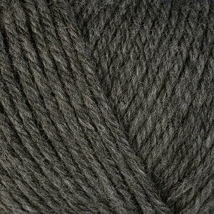 Granite 33107, a medium heathered grey skein of washable worsted weight Ultra Wool yarn.