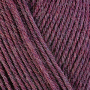 Heather 33153, a heathered pink skein of washable worsted weight Ultra Wool yarn.