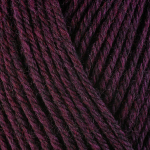 Hollyhock 33159, a dark heathered burgundy-purple skein of washable worsted weight Ultra Wool yarn.
