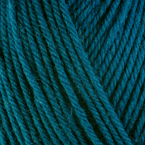 Kale 3341, a dark turquoise blue skein of washable worsted weight Ultra Wool yarn.