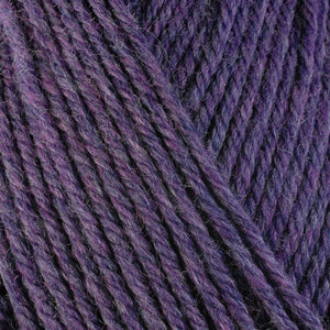 Lavender 33157, a deep heathered purple skein of washable worsted weight Ultra Wool yarn.