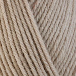 Oat 3305, a very light tan skein of washable worsted weight Ultra Wool yarn.