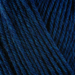 Ocean 33152, a dark blue blue skein of washable worsted weight Ultra Wool yarn.