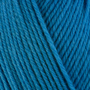 River 3326, a soft blue skein of washable worsted weight Ultra Wool yarn.