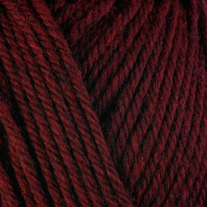 Sour Cherry 33145, a dark candy red skein of washable worsted weight Ultra Wool yarn.