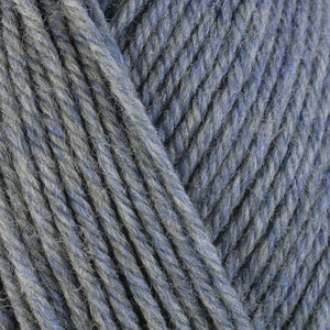 Stonewashed 33147, a light heathered blue-grey skein of washable worsted weight Ultra Wool yarn.