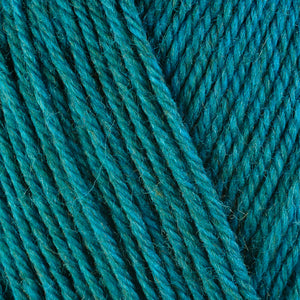 Verbena 33139, a heathered bright turquoise blue skein of washable worsted weight Ultra Wool yarn.