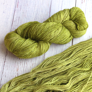 A twisted hank of Plymouth Yakima Yarn in Avocado green