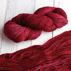 A twisted hank of Plymouth Yakima Yarn in Crimson red